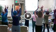 teresa leading laughter yoga at Marin Cancer Institute
